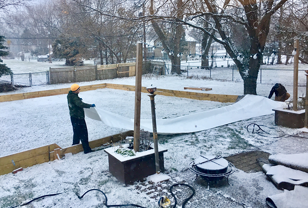 "Joseph Climek lays down the plastic sheet on his backyard rink in Webster, ""Mos Iceley."" - PHOTO COURTESY OF JOSEPH CLIMEK AND MELODY KING"