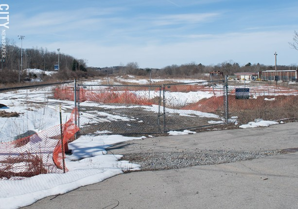 Mark IV cleaned up 75 Monroe Avenue to build an apartment complex. But the site has sat idle while approval processes and lawsuits play out. - FILE PHOTO
