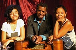 Miché with his daughters, Naomi Fambro, left, and Michael Fambro. - PHOTO PROVIDED