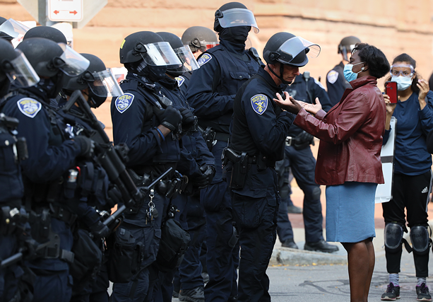 The Rev. Myra Brown confronts Rochester police officers to broker a peaceful resolution to their standoff with Black Lives Matter protestors on Sept. 16, 2020. - PHOTO BY MAX SCHULTE