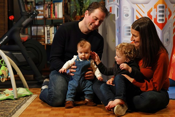 Rachel and David Berk with their children, 4-month-old Harper and 2-year-old Owen. The Berks will be moving into their new home in Pittsford in March. - PHOTO BY MAX SCHULTE