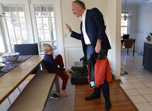 Douglas Maguire and his 6-year-old son, Charlie, in their Pittsford home. - PHOTO BY MAX SCHULTE