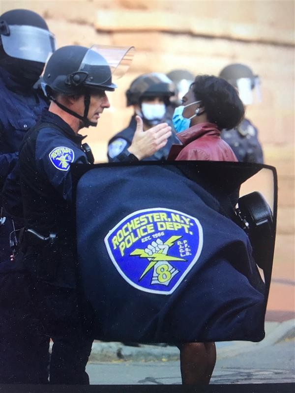 Rochester Police Department Capt. Ray Dearcop speaks with the Rev. Myra Brown during a protest outside City Hall on Sept. 16, 2020. - PHOTO ILLUSTRATION BY MAX SCHULTE