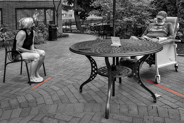 """In his photograph """"RIP 8-24-20,"""" Rochester-based artist Donald Menges documented the first face-to-face visit his friend Joe had with his daughter in months. Joe had been living in a nursing home and died shortly after this picture was taken. - PHOTO PROVIDED"""