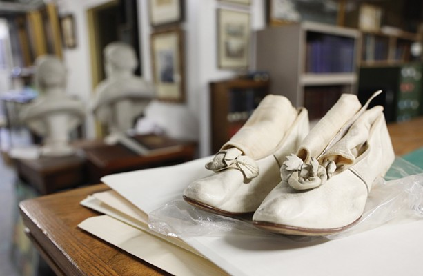 Shoes made by a Rochester cobbler for his bride on their wedding day are part of the Rochester Historical Society's collection. - PHOTO BY MAX SCHULTE