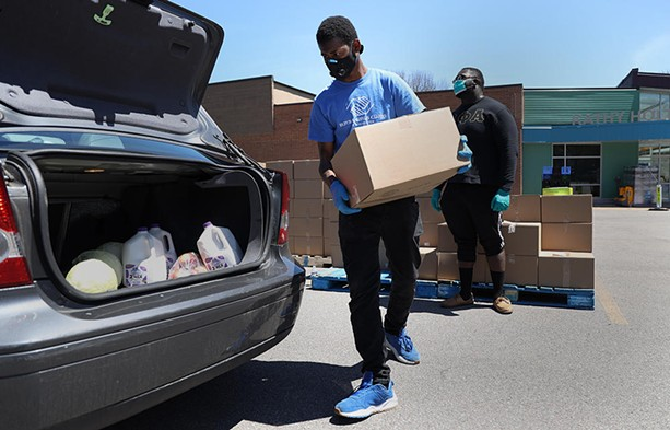 An emergency food distribution on Genesee Street, run by Foodlink in May 2020. - PHOTO BY MAX SCHULTE / WXXI NEWS