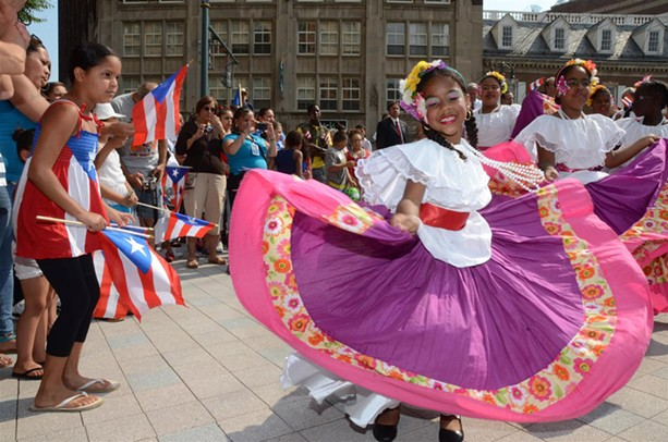 A young girl dances at the Puerto Rican Festival parade. - FILE PHOTO