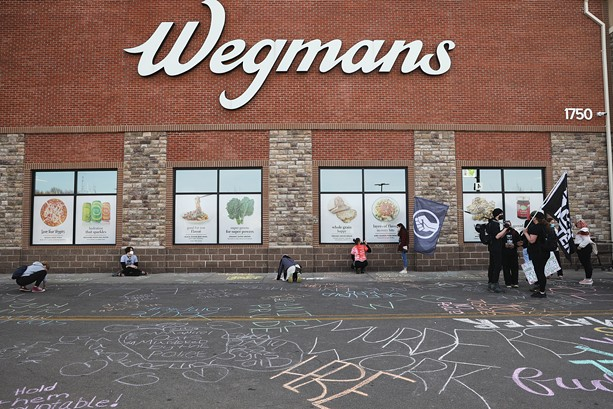 Black Lives Matter activists protested in front of Wegmans on East Avenue in Rochester on March 23 to mark the one-year anniversary of Daniel Prude's fatal encounter with city police. - PHOTO BY MAX SCHULTE