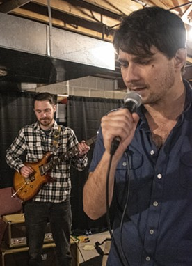 Guitarist Mark Bamann (left) at a FRAN rehearsal with Jon Lewis. - PHOTO BY JACOB WALSH