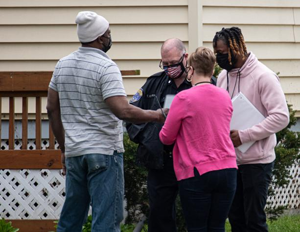 Members of the PIC Team meet with RPD and a case worker for a report of a man in crisis. - PHOTO BY JACOB WALSH