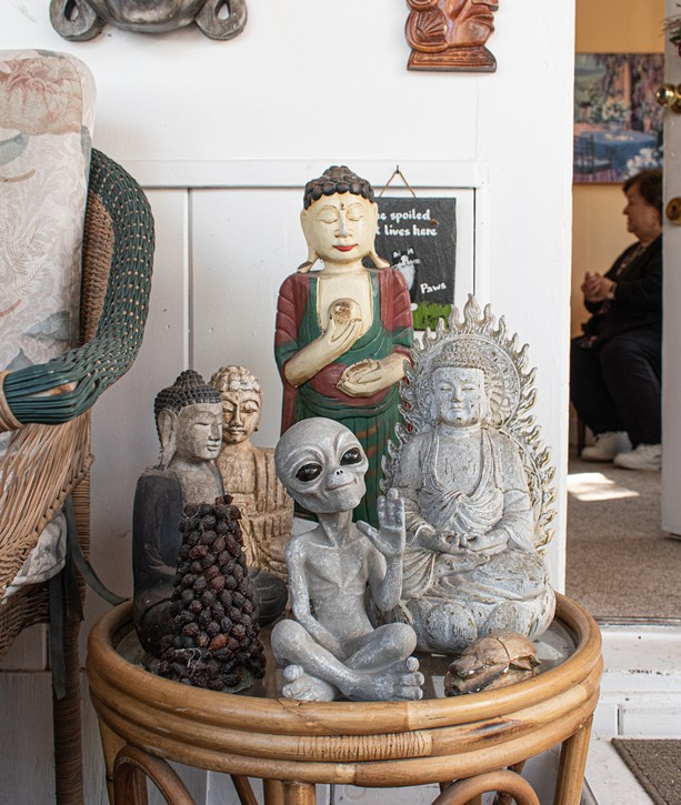 Alien and Buddhist figurines in Stringfellow's home. - PHOTO BY JACOB WALSJ
