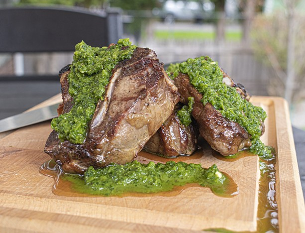 Grilling lamb chops and topping them with mint chutney is just one of the ways to prepare the versatile but often overlooked meat. - PHOTO BY JACOB WALSH