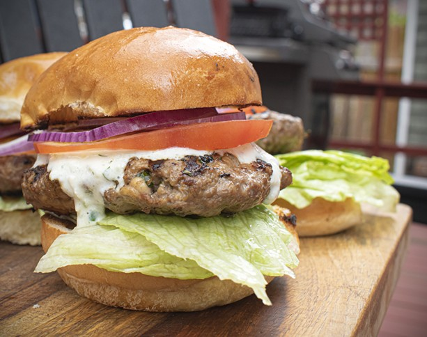 Crumbled feta cheese mixed into the patties really makes these lamb burgers pop. - PHOTO BY JACOB WALSH