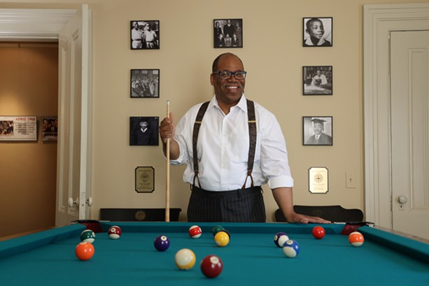 The pool table was in the basement of the main dormitory at Crozer Theological Seminary, where Martin Luther King Jr. attended from 1948 to 1951 and is said to have been introduced to billiards. It now sits in Van White's law office on Grove Place. - PHOTO BY MAX SCHULTE