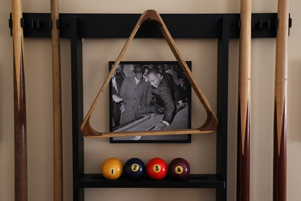 """Martin Luther King Jr.'s use of pool to connect with people and advance the struggle for civil rights is well documented. The best known image of King playing pool was taking in 1966 in Chicago during an """"anti-slum campaign."""" The photo is among the paraphernalia in Van White's room dedicated to """"King's table."""" - PHOTO BY MAX SCHULTE"""