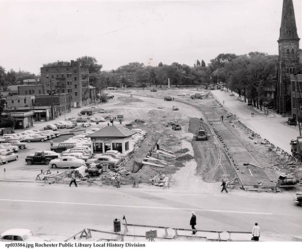 The Plymouth Avenue South section of the Inner Loop under construction. First Presbyterian Church, corner of Spring Street, at right. The Standish (apartment house) in background, left of center. Monument to Fox Sisters and beginnings of Spiritualism in background. 1953-1958 - PHOTO COURTESY OF THE LOCAL HISTORY & GENEOLOGY DIVISION, ROCHESTER PUBLIC LIBRARY