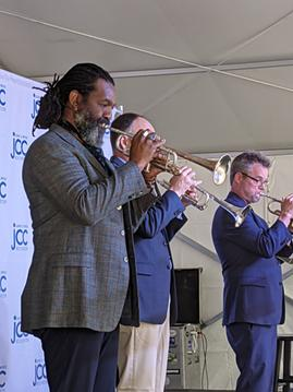 RPO trumpeters Herb Smith, Wesley Nance, and Douglas Prosser perform at the launch of the Dawn Lipson Canalside Stage at the JCC of Greater Rochester on June 2, 2021. - PHOTO BY DANIEL J. KUSHNER