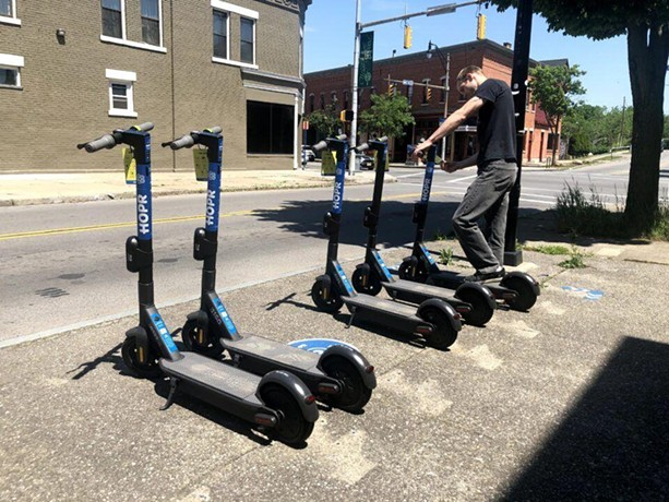 A worker lines up some of the electric scooters that HOPR uses in its bike and scooter share program. - PHOTO PROVIDED BY HOPR