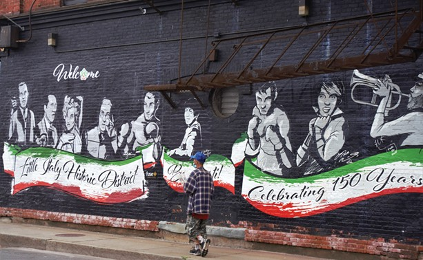 The Little Italy mural on the Flatiron Building contains Italian-American, and not-so-Rochesterian, icons like Liza Minelli, Rocky Marciano, and Frank Sinatra. - PHOTO BY GINO FANELLI