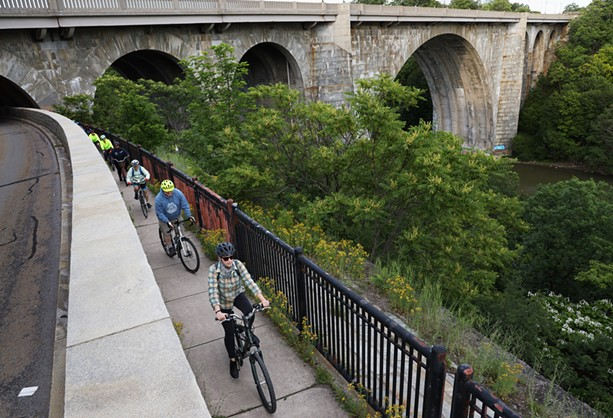 Reconnect Rochester is leading a series of bike rides this summer where they'll show people how to navigate the city by bicycle. The first ride went from Maplewood Park to High Falls along the Genesee River. - PHOTO BY MAX SCHULTE