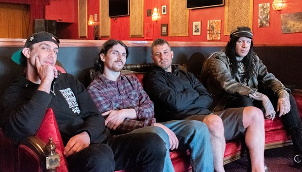 Sound engineer Jon Lalopa, custodian Alex Gethway, Nielsen, and and promoter James Von Sinn in Photo City's newly expanded main room. - PHOTO BY JACOB WALSH