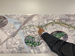 A man points at concept five for the Inner Loop. - PHOTO PROVIDED BY CITY OF ROCHESTER