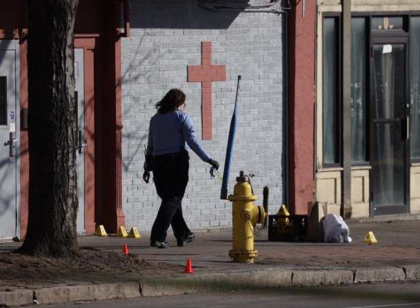 Officers investigate scene of fatal shooting by police of a man with a knife in March 2021. - PHOTO BY MAX SCHULTE / WXXI NEWS