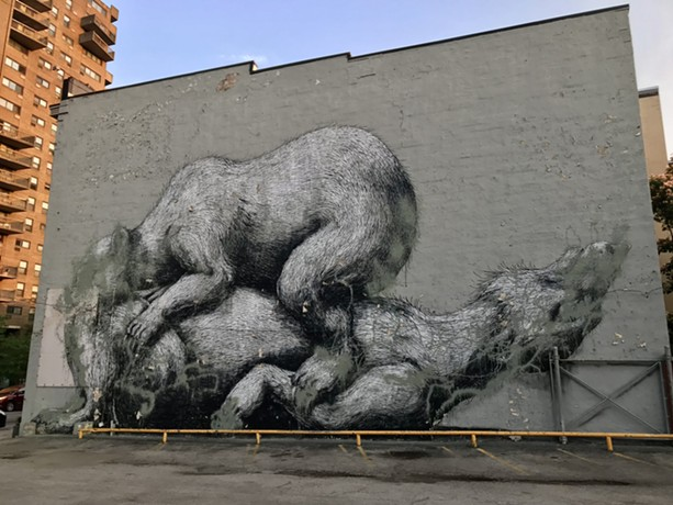 A mural by Belgian artist ROA, painted in 2012 for the inaugural Wall/Therapy festival, has been defaced by an unknown vandal. - PHOTO BY DAVID ANDREATTA
