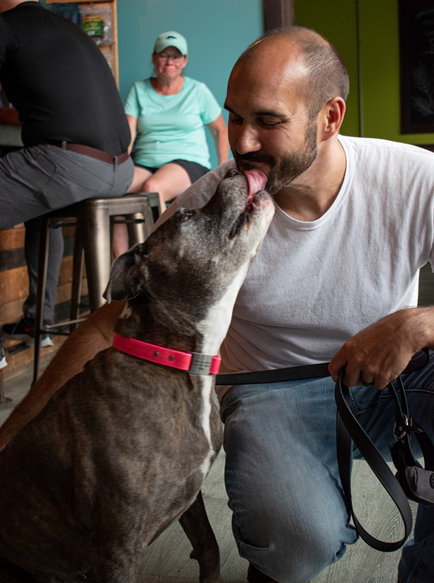 Brindle Haus owner John Boothe and his dog, Mia. - PHOTO BY JACOB WALSH
