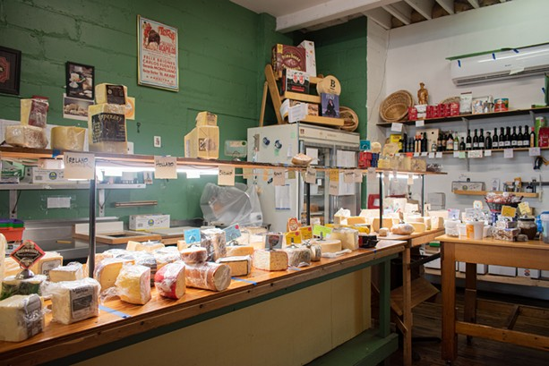 The cheese counter at VM Giordano Inc. — European Cheese Shop. - PHOTO BY JACOB WALSH