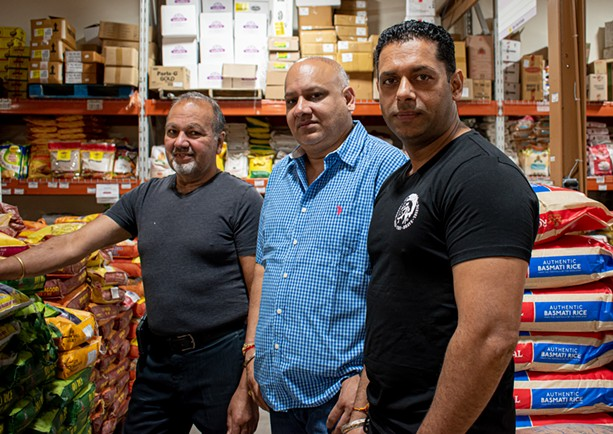 Harwinder Singh (right) leads the family-run grocery store Namaste Cash & Carry along with Harcharnjit Singh (middle) and Gurpal Singh (left). - PHOTO BY JACOB WALSH
