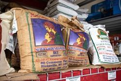Varieties of basmati rice at Namaste Cash & Carry. - PHOTO BY JACOB WALSH