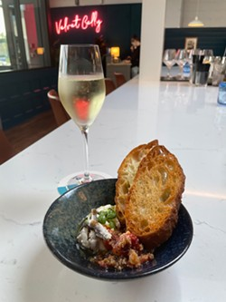 Velvet Belly's House-made Ricotta, which is served with roasted cherry tomato 'pappa al pomodoro,' marinated Spanish anchovies, and crostini. - PHOTO BY REBECCA RAFFERTY