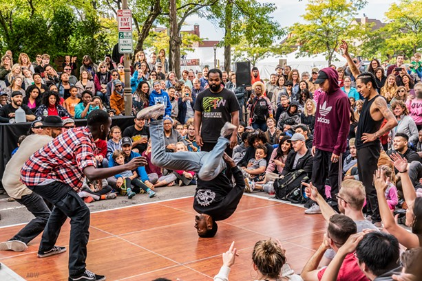 A B-boy performs as other dancers look on at Fringe Street Beat as part of the 2018 Rochester Fringe Festival. - PHOTO BY AARON WINTERS