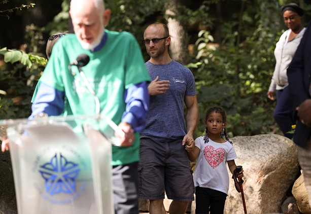 Robert Allen and his daughter, Kaylee Allen, stumble into a press conference after hiking in Washington Grove. - PHOTO BY MAX SCHULTE / WXXI NEWS