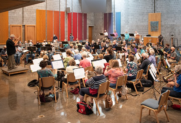 Larry Neeck conducts the New Horizons Concert Band and Symphonic Band in a rehearsal for its 30th anniversary concert on Oct. 29, 2021. - PHOTO BY JACOB WALSH