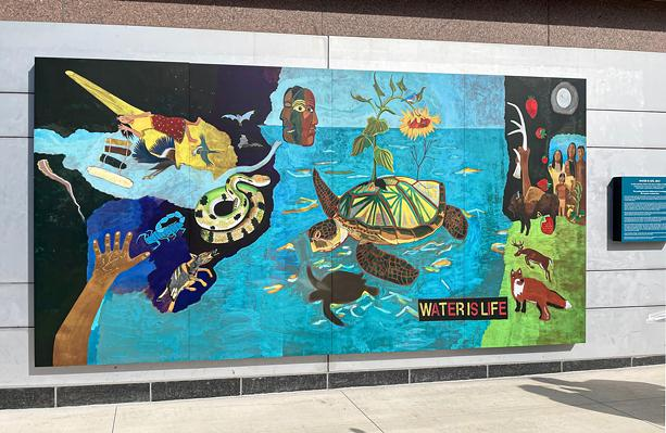 """Peter Jemison's mural, """"Water is Life,"""" depicts the Haudenosaunee creation story. - PHOTO BY REBECCA RAFFERTY"""