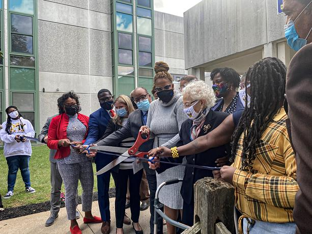 Surrounded by students and school and city officials, Dr. Alice Holloway Young takes part in Wednesday's ceremony renaming School 3 in her honor. - PHOTO BY RACQUEL STEPHEN / WXXI NEWS
