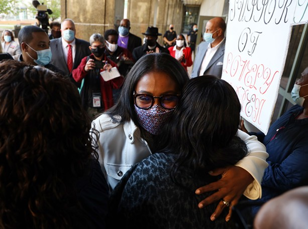 Mayor Lovely Warren exited the courthouse to a throng of supporters after her arraignment on felony charges related to alleged campaign finance violations on Oct. 5, 2020. - PHOTO BY MAX SCHULTE