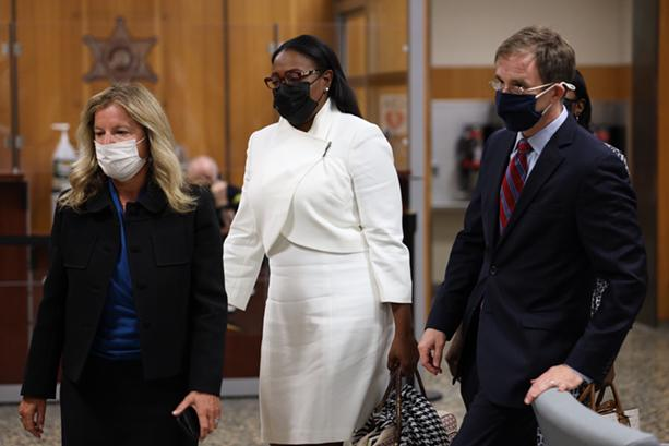 Mayor Lovely Warren enters Monroe County Court on Monday with her attorneys Carrie H. Cohen and Nathan Reilly. Warren's trial on campaign finance charges was scheduled to begin, but she and her co-defendants accepted a plea deal. - PHOTO BY MAX SCHULTE