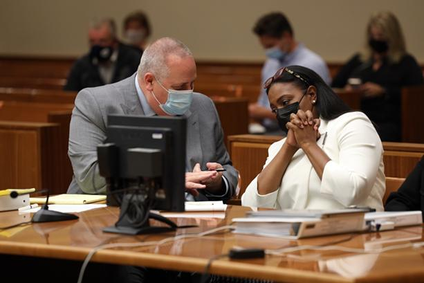 Mayor Lovely Warren confers with her primary attorney, Joe Damelio, in court, where she accepted a plea deal. - PHOTO BY MAX SCHULTE