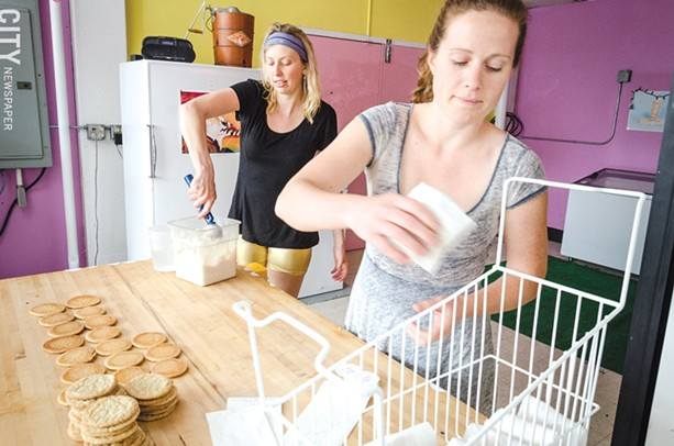 Augustine and Odhner prepare ice cream sandwiches in their space in the Hungerford Building. - PHOTO BY MARK CHAMBERLIN