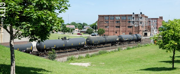 Trains carrying oil, like the ones above, drive through neighborhoods filled with schools, hospitals and houses. - PHOTO BY MARK CHAMBERLIN