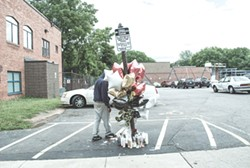 One of the memorials to the victims of the drive-by shooting on Genesee Street last week. - PHOTO BY MARK CHAMBERLIN