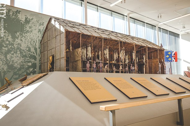 A model of Ganondagan's longhouse in the SACC gallery space. - PHOTO BY MARK CHAMBERLIN