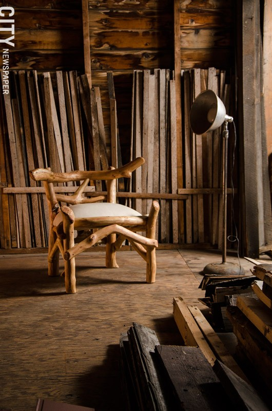 Dow creates rustic furniture from scavenged wood. - PHOTO BY MARK CHAMBERLIN