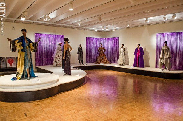 Above; Stunning ensembles — the creations of iconic couture designers as well as up-and-coming black designers — from 50 years of the Ebony Fashion Fair are installed in the MAG's Grand Gallery. - PHOTO BY MARK CHAMBERLIN