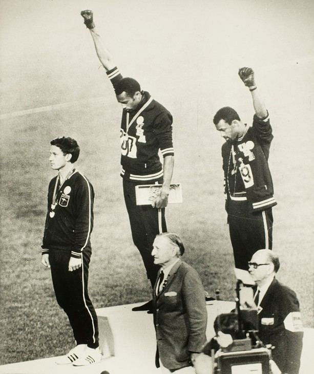"""The iconic image, """"Olympic Racial Protest,"""" captured sprinters Tommie Smith and John Carlos during the medal ceremony. Unknown photographer. - PHOTO COURTESY GEORGE EASTMAN MUSEUM"""