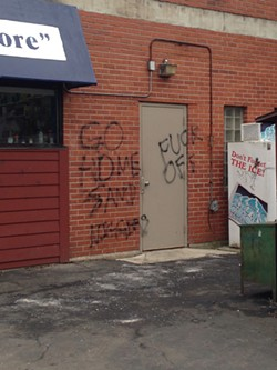 """Messages spray-painted on the Corner Store include """"Go home, sand niggers,"""" a slur directed at the Arab-Americans who operate the neighborhood business. - PHOTO BY MELODY BOYD"""