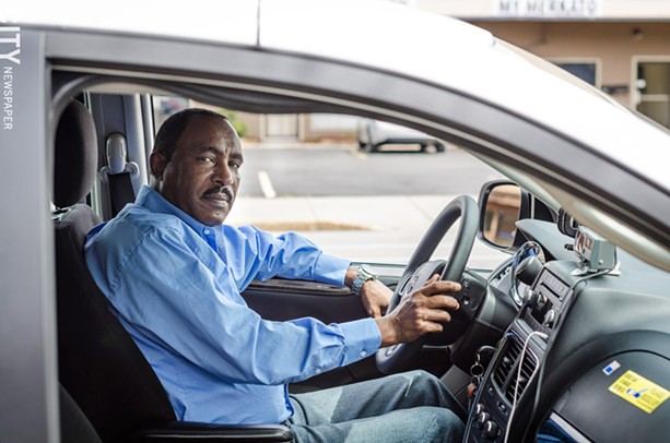 Melkie Demissie, a Rochester cab driver and owner of Park Avenue Taxi. - PHOTO BY MARK CHAMBERLIN